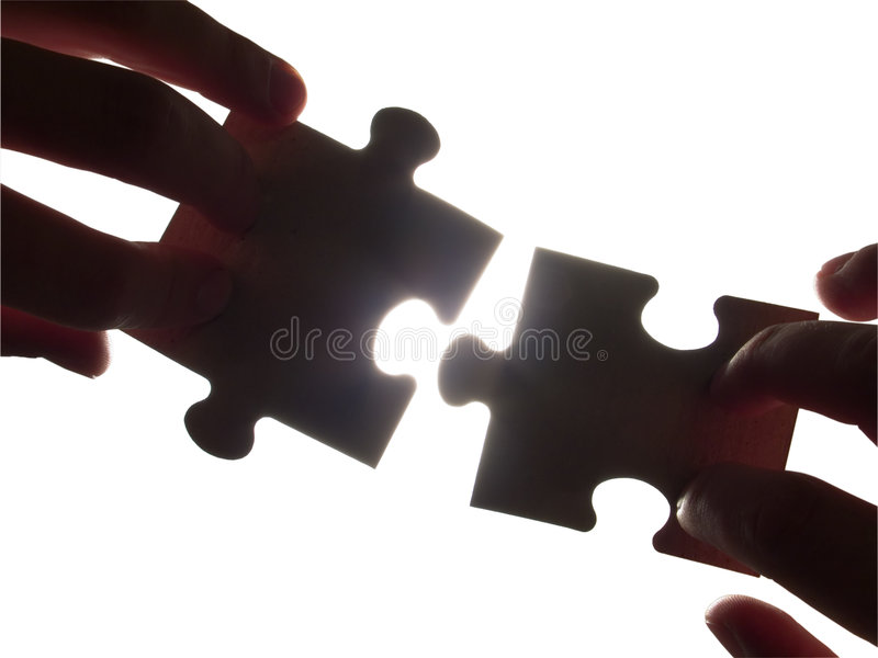 Ready for contact. Two hands trying to fit puzzle pieces, isolated with clipping path