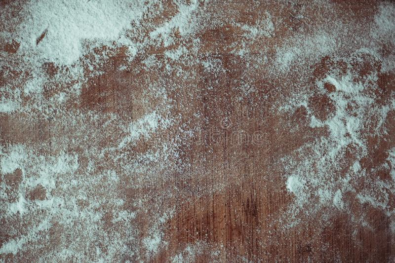 A wooden board with flour. Texture royalty free stock photo