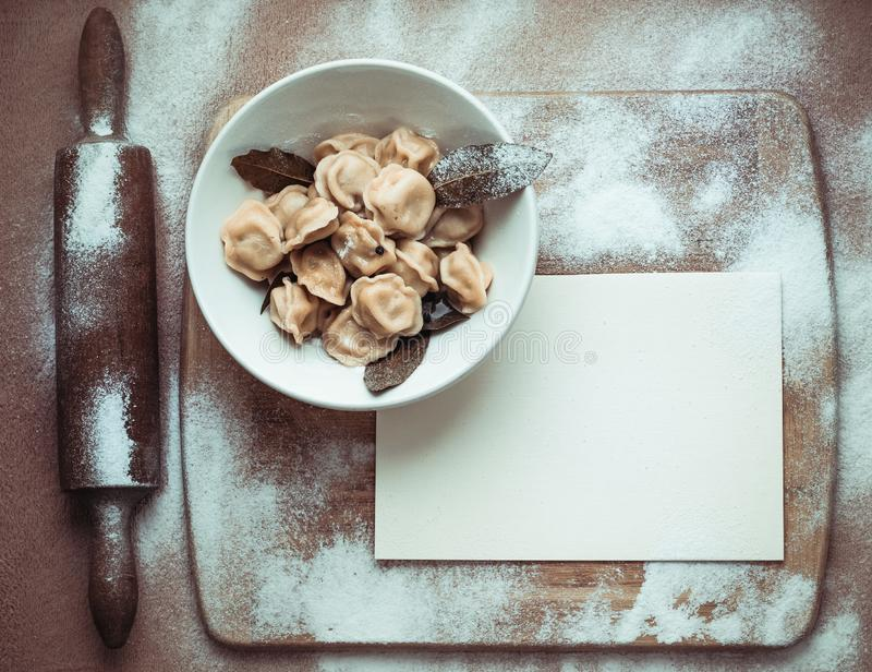 Ready dumplings in a plate on a wooden board stock photos