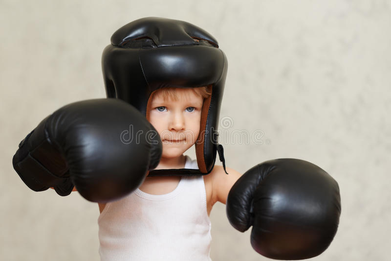 Ready for fighting. Boxer child ready for fighting
