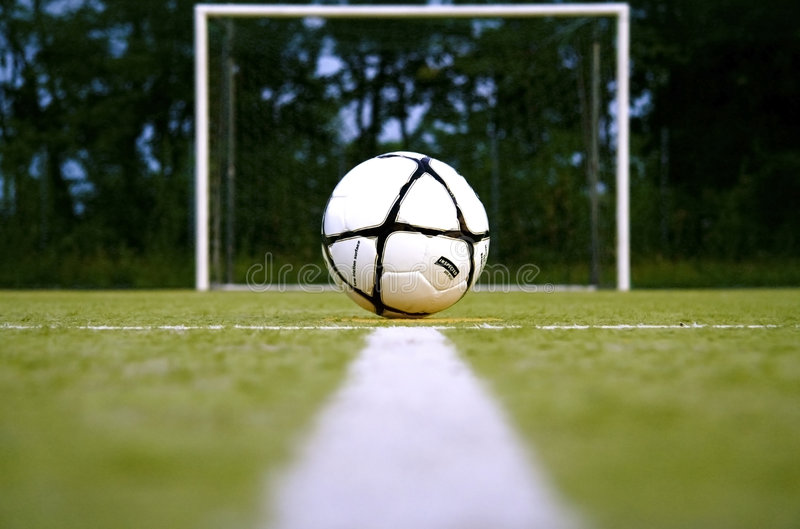 Ready fo the goal. A soccer ball in front of a soccer door stock image