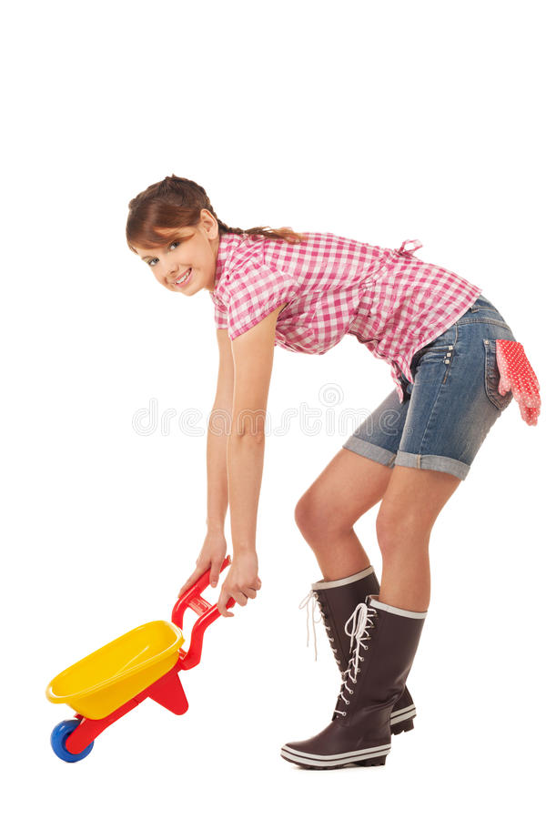 Ready for gardening. Girl with wheelbarrow is ready for gardening royalty free stock images