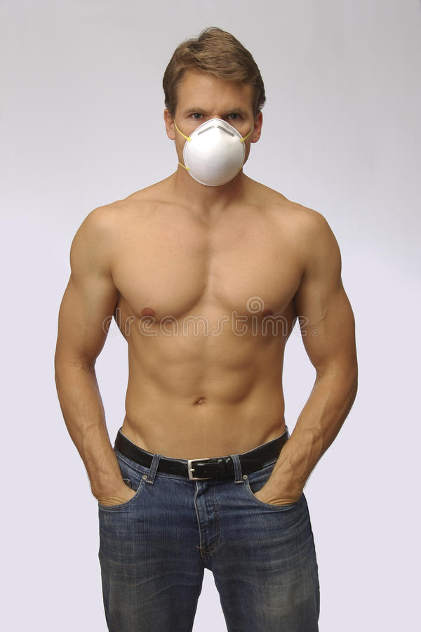 Ready for H1N1. Topless handsome man wearing mask to protect from H1N1 stock photo