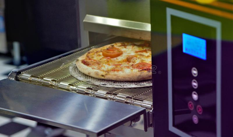 Ready Italian pizza on thin dough, fresh from the oven, Selective focus. royalty free stock photography
