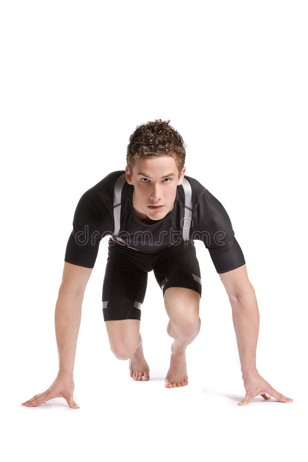 Ready for Race. An athlete at the start of a race, isolated on a white background stock photo