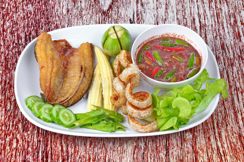 Ready served Spicy shrimp paste dip as Nam Prik Kapi. Ready served of Spicy shrimp paste dip as Nam Prik Kapi in Thai with deep fired Sun-dried striped stock photography