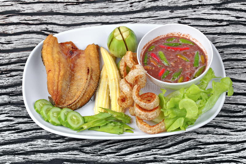 Ready served Spicy shrimp paste dip as Nam Prik Kapi. Ready served of Spicy shrimp paste dip as Nam Prik Kapi in Thai with deep fired Sun-dried striped royalty free stock photo