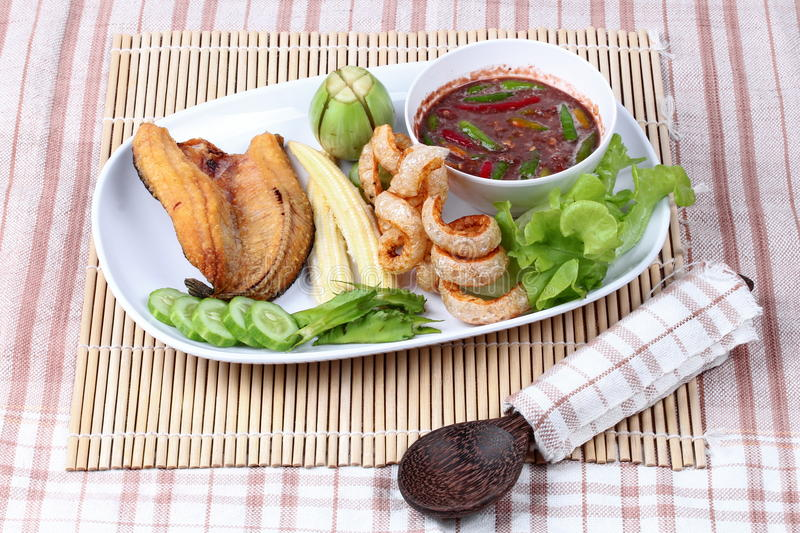 Ready served Spicy shrimp paste dip as Nam Prik Kapi. Ready served of Spicy shrimp paste dip as Nam Prik Kapi in Thai with deep fired Sun-dried striped stock photo