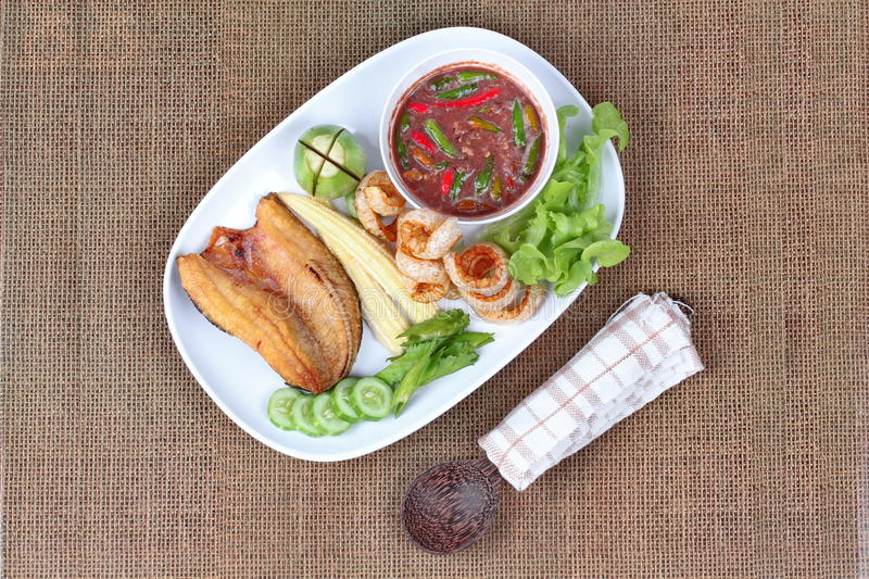 Ready served Spicy shrimp paste dip as Nam Prik Kapi. Ready served of Spicy shrimp paste dip as Nam Prik Kapi in Thai with deep fired Sun-dried striped stock photos