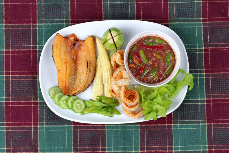 Ready served Spicy shrimp paste dip as Nam Prik Kapi. Ready served of Spicy shrimp paste dip as Nam Prik Kapi in Thai with deep fired Sun-dried striped royalty free stock image
