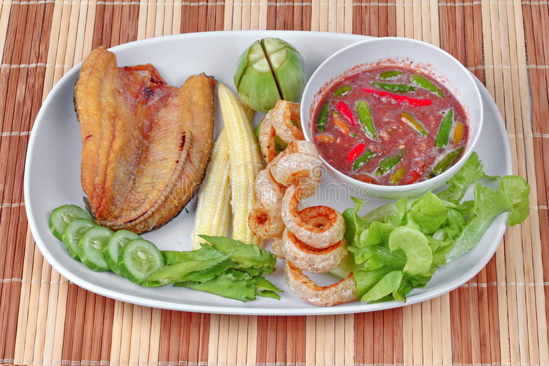 Ready served Spicy shrimp paste dip as Nam Prik Kapi. Ready served of Spicy shrimp paste dip as Nam Prik Kapi in Thai with deep fired Sun-dried striped stock image