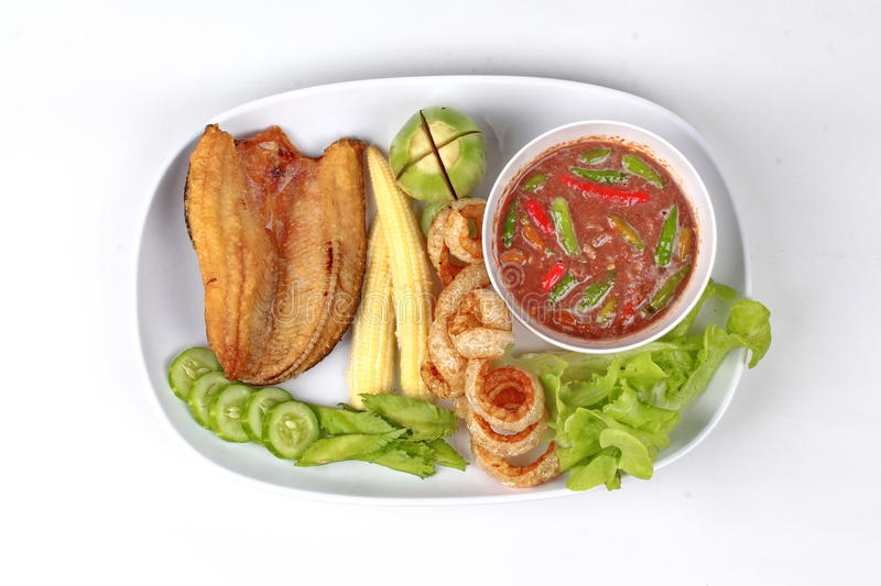 Ready served Spicy shrimp paste dip as Nam Prik Kapi. Ready served of Spicy shrimp paste dip as Nam Prik Kapi in Thai with deep fired Sun-dried striped stock images