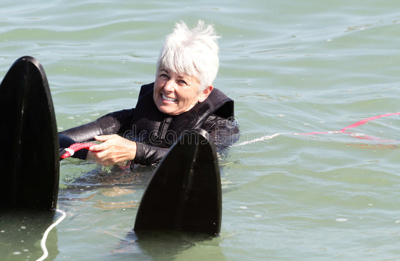 Ready Set Go. Older Lady Water Skiing stock photo