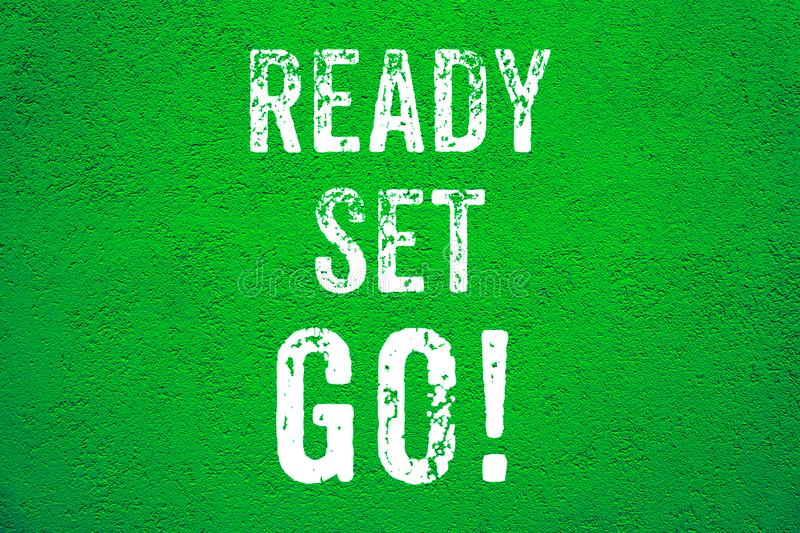 Ready Set Go! white words text on green grungy stucco cement wall background motivational message banner royalty free stock images