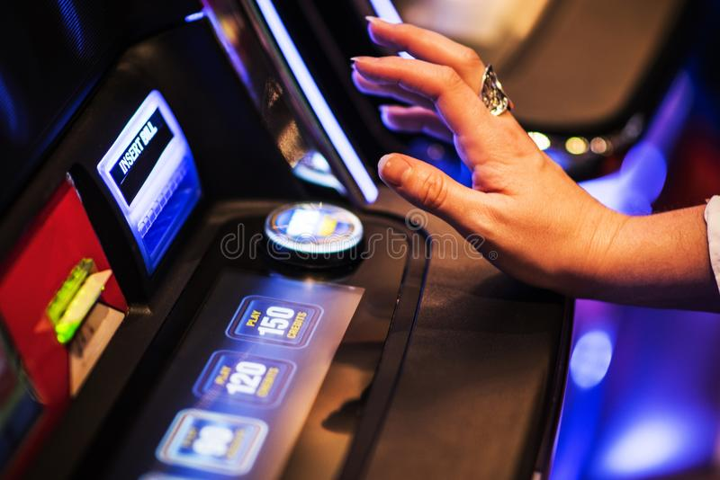 Ready For Slot Machine Spin. Gambling in the Casino Concept. Caucasian Woman Playing Game stock image