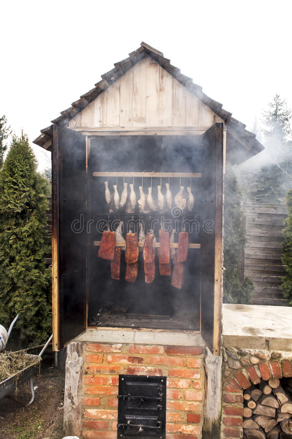 Ready-smoked meat in the smokehouse royalty free stock photo