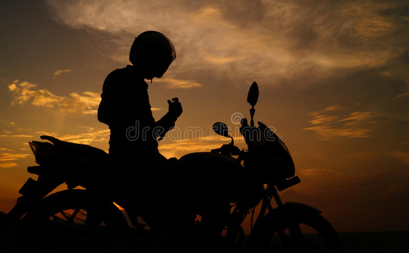 Ready steady and go. Silhouette of a generic sport motorbike and biker. concept of people, transportation royalty free stock images