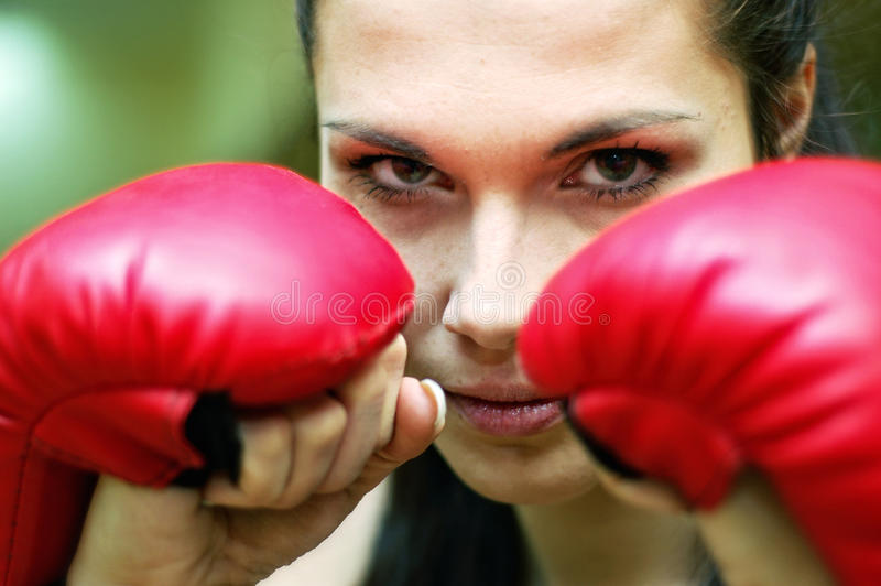 Ready to attack. Girl boxer is ready to attack stock image