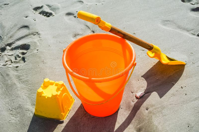 A Shovel and Pail on the Beach. Ready to build a sandcastle with this shovel and pail on the beach royalty free stock photos