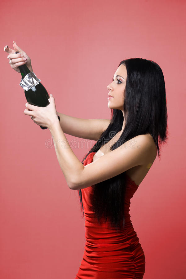 Ready to celebrate. Gorgeous young brunette woman ready to celebrate with champagne stock photography