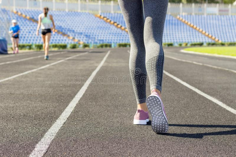 Ready to go. Close up photo of shoe of female athlete on the starting line. Girl on Stadium track, preparing for a run. Sports and. Healthy concept royalty free stock photos