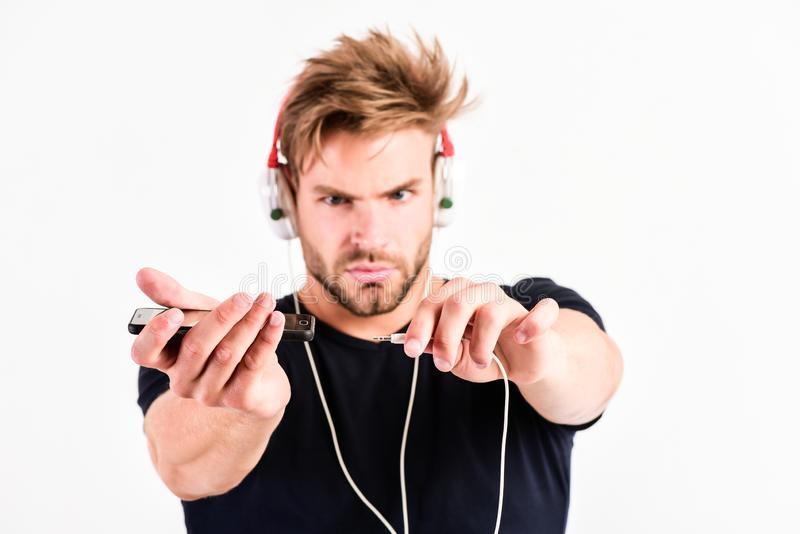 Ready to listening to music. mp3 player. sexy muscular man listen music on phone mp3 player. man with mp3 player on. Phone isolated on white. unshaven man in royalty free stock images