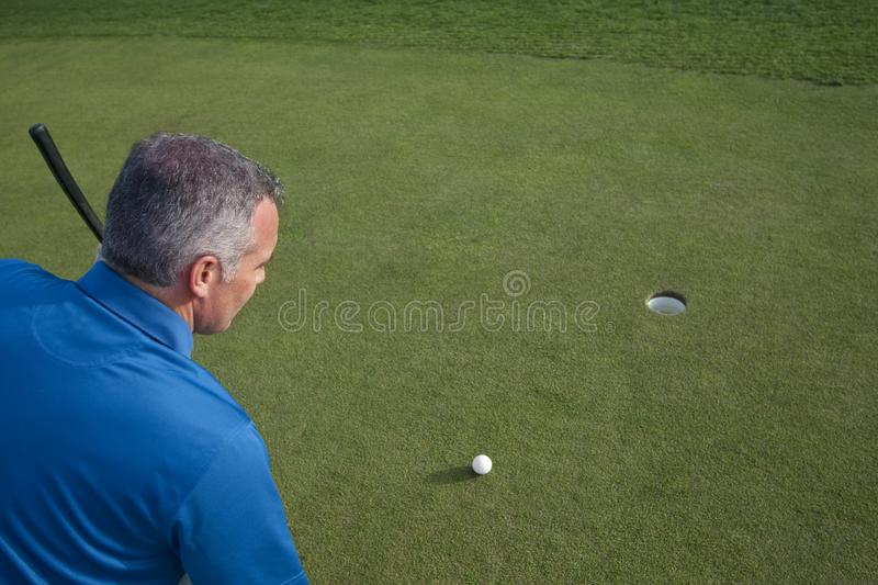 Download Ready to Make a Golf Putt stock photo. Image of gray - 13634696
