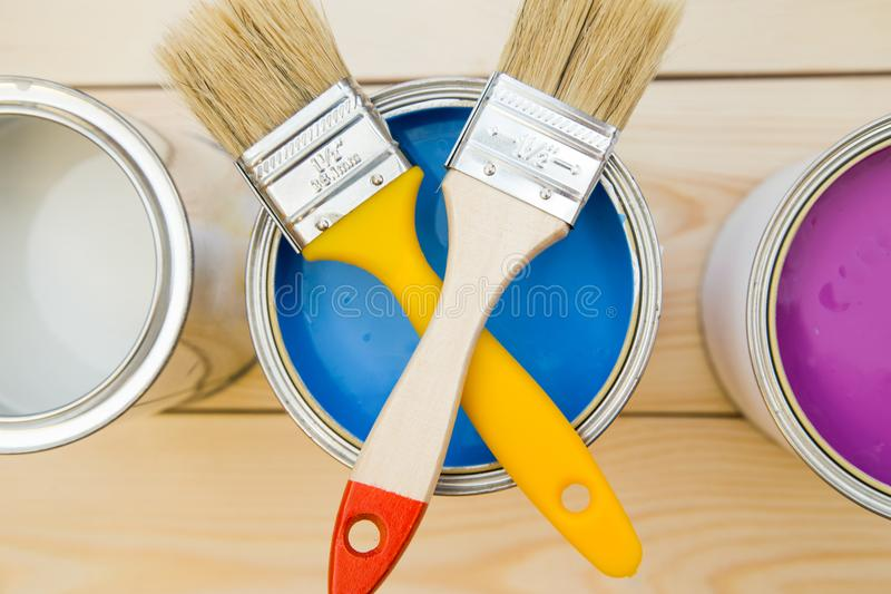 Cans of household paint and brushes stock photos