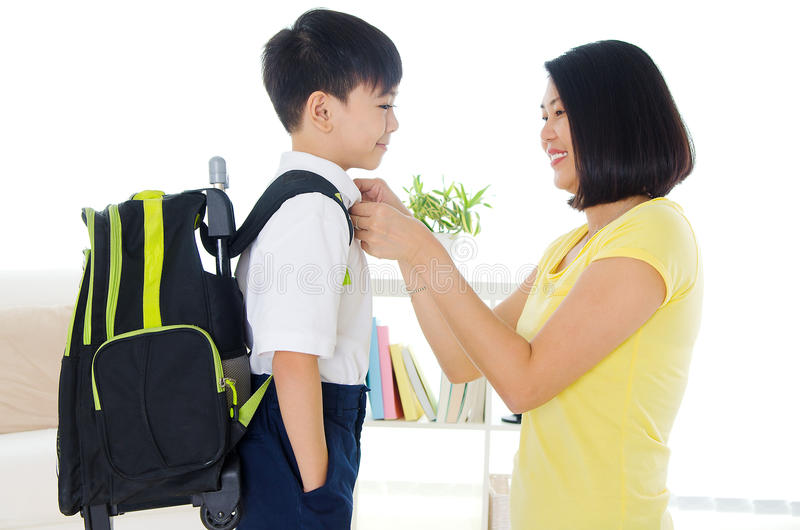 Ready to school. Asian mother get her son ready to school royalty free stock images