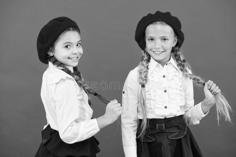 Ready to study. Education abroad. kid fashion. friendship and sisterhood. best friends. little girls in french beret stock image