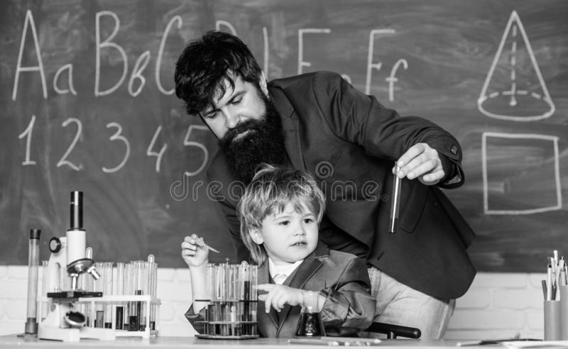 Ready to success. using microscope in lab. Back to school. father and son at school. student doing science experiments royalty free stock photo