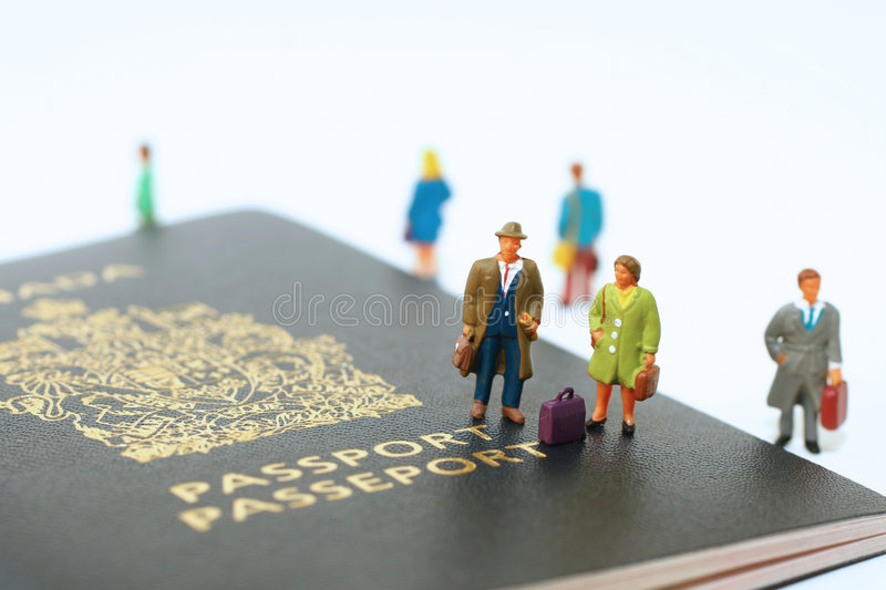Ready to travel. Mini people standing on canadian passport ready to travel