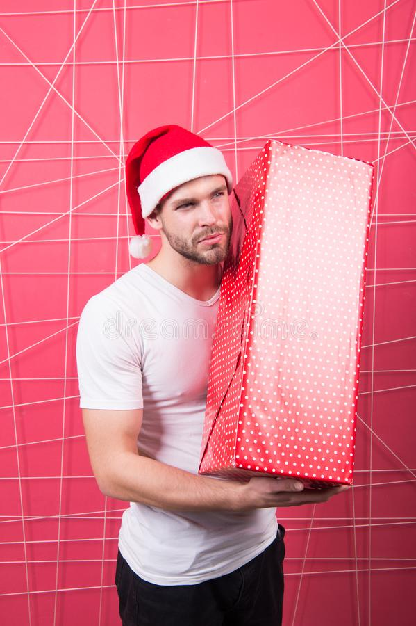 Ready to unpack your gift. Christmas holiday celebration. Man handsome unshaven santa hat hold gift box. Christmas gift stock images
