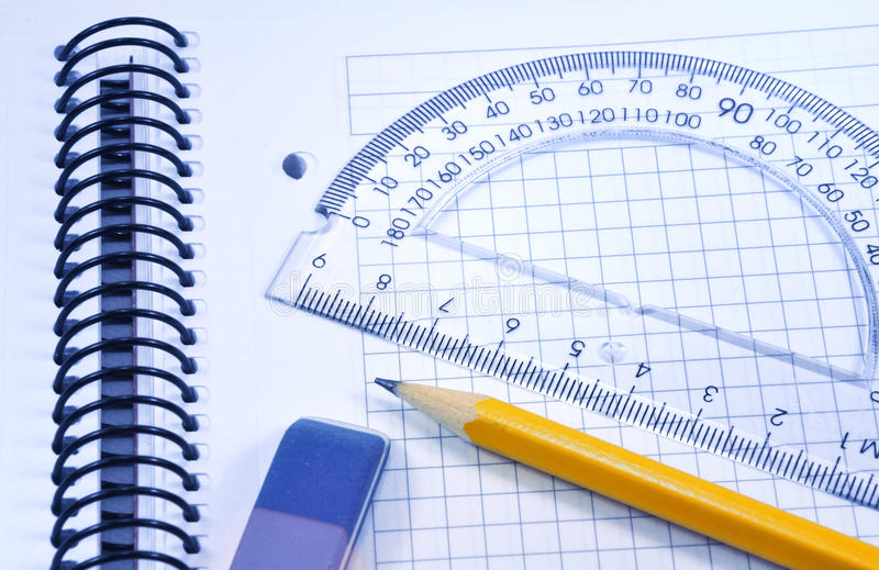 Ready to work. Orange graphite pencil, eraser and ruler - ready to work royalty free stock photo