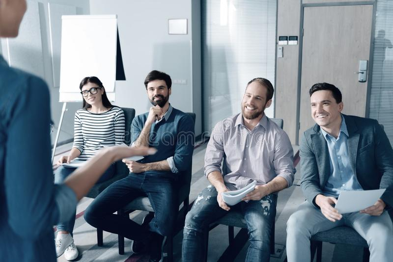 Positive colleagues listening to their boss in the office royalty free stock photos