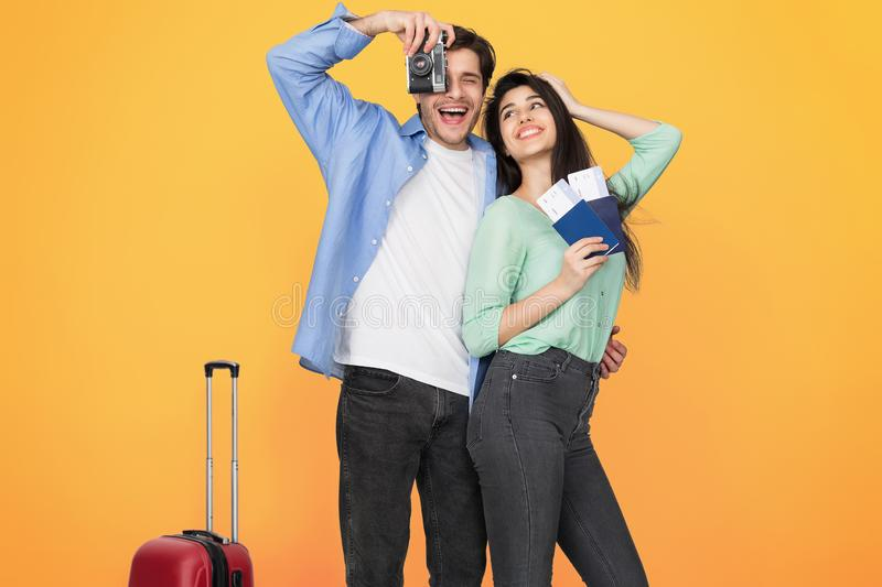Ready for travel. Happy couple with suitcase and tickets stock photography