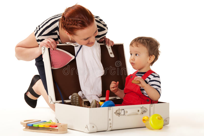 Ready for vacations. Little boy is sitting in the suitcase ready for vacations to start stock photos