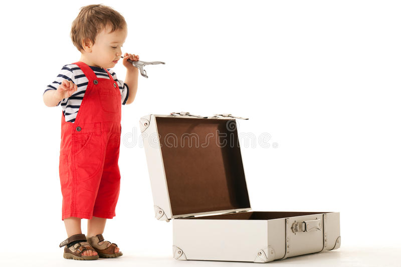 Ready for vacations. Little boy packing stuff for vacations stock images