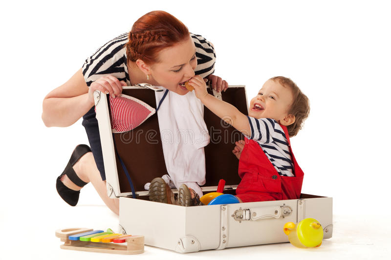 Ready for vacations. Little boy in suitcase wanting to go for vacations with you royalty free stock photo