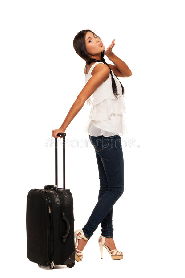 Ready for vacations. Girl with suitcase is ready for vacation royalty free stock photography