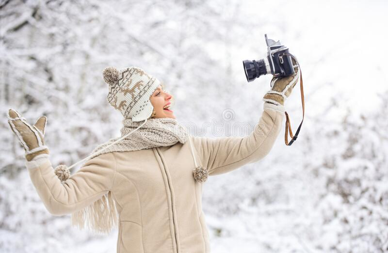 Ready for weather forecast. expedition. winter girl with vintage camera. happy woman make selfie on camera. winter royalty free stock photo