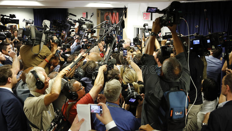 REAGAN PRESIDENTIAL LIBRARY, SIMI VALLEY, LA, CA - SEPTEMBER 16, 2015,cameras surround Donald Trump in spin room during the Republ. Ican presidential debate at royalty free stock images