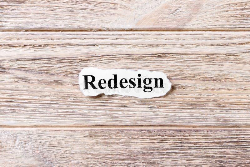 REAJUSTE de la palabra en el papel Concepto Palabras del REAJUSTE en un fondo de madera foto de archivo libre de regalías