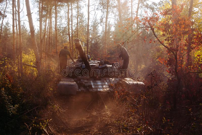 Real battle tanks disguised in the trenches Donbass Ukraine stock photo