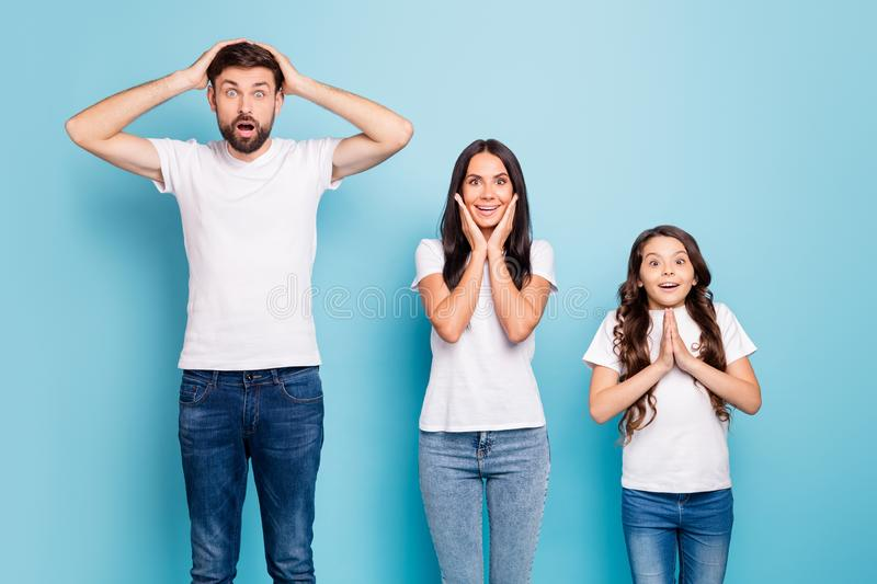 Real discounts. Portrait of astonished full big family hear information scream wow omg wear white t-shirt denim jeans stock photography