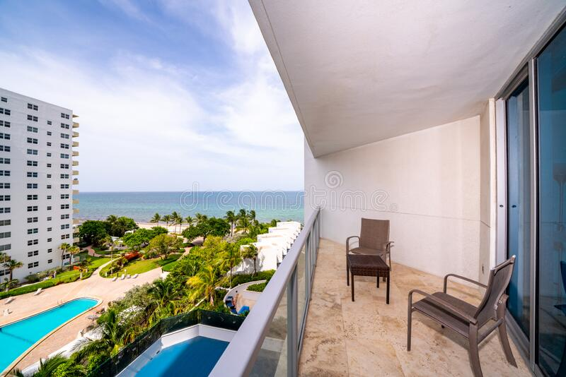 Real estate photography balcony view partial side view of ocean stock image