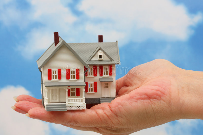Real Estate. House on hand sky background stock image