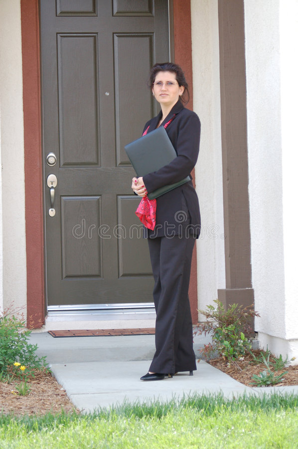 Real Estate Agent In Front of Home stock photo