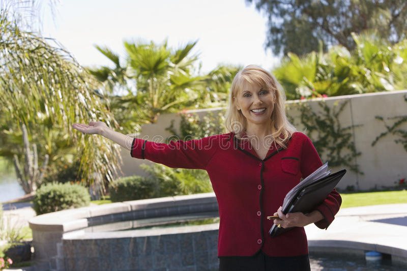 Download Real Estate Agent Gesturing Stock Photo - Image: 29646890