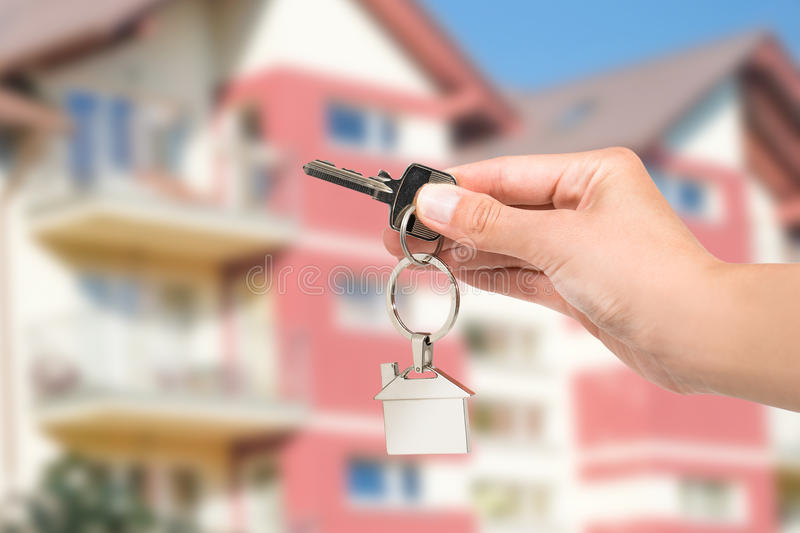 Real estate agent giving house key. stock images